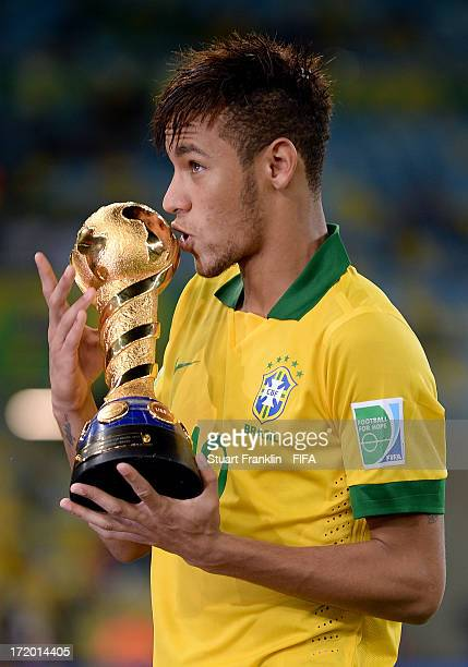 Neymar of Brazil kisses the trophy at the end of the FIFA Confederations Cup Brazil 2013 Final match between Brazil and Spain at Maracana on June 30...