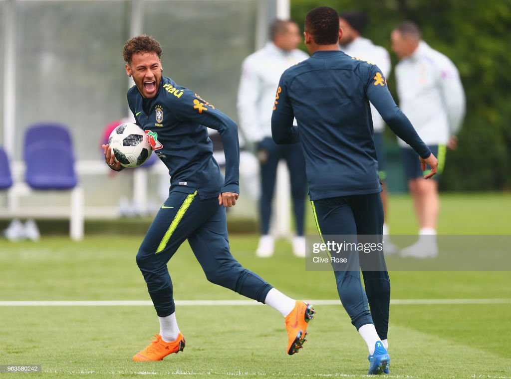 Neymar of Brazil laughs during a Brazil training session ahead of the international friendly between Brazil and Croatia at Tottenham Hotspur Training Centre on May 29, 2018 in Enfield, England.