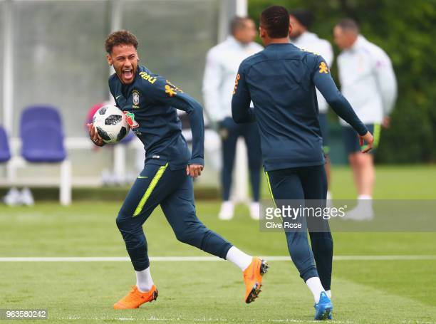 Neymar of Brazil laughs during a Brazil training session ahead of the international friendly between Brazil and Croatia at Tottenham Hotspur Training...
