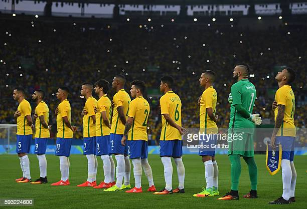 Neymar of Brazil leads the team in the National Anthem during the Men's Football Final between Brazil and Germany at the Maracana Stadium on August...