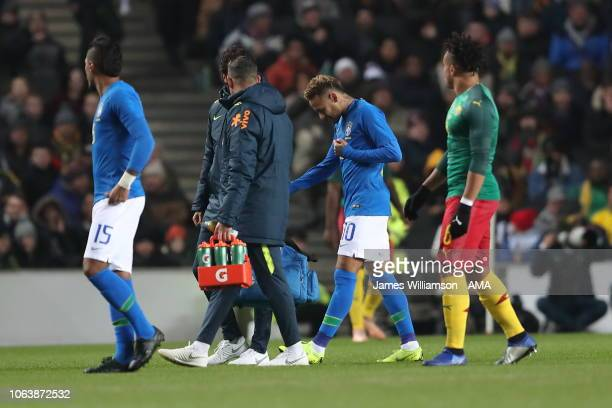 Neymar of Brazil leaves the field through injury during the International Friendly match between Brazil and Cameroon at Stadium mk on November 20...