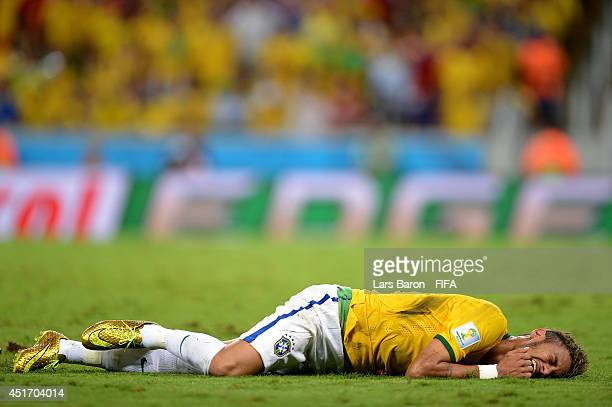 Neymar of Brazil lies injured during the 2014 FIFA World Cup Brazil Quarter Final match between Brazil and Colombia at Estadio Castelao on July 4...