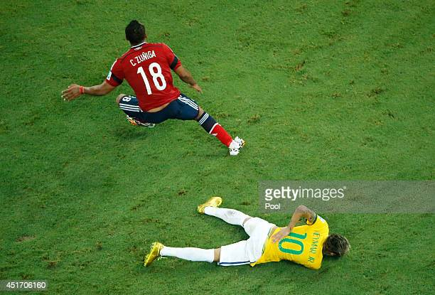 Neymar of Brazil lies on the pitch after a challenge by Juan Camilo Zuniga of Colombia during the 2014 FIFA World Cup Brazil Quarter Final match...