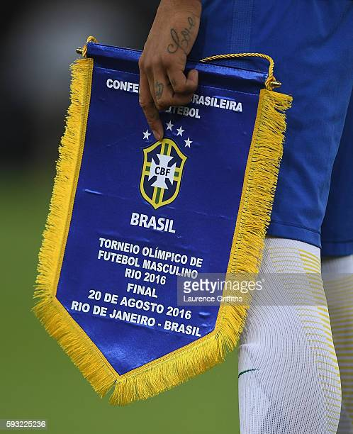 Neymar of Brazil lines up for his national anthem before during the Men's Football Final between Brazil and Germany at the Maracana Stadium on August...