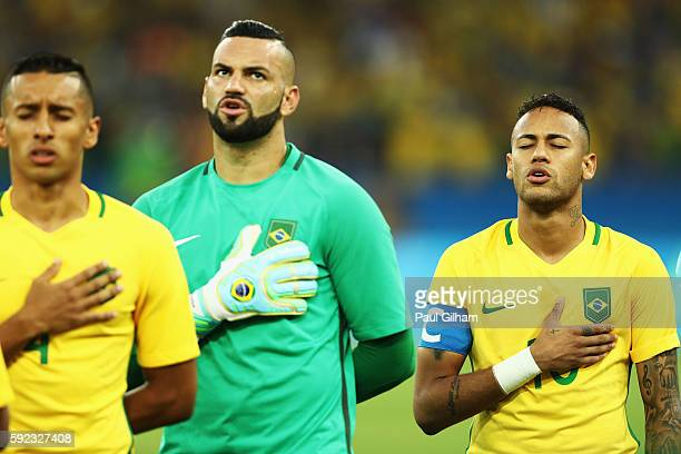 Neymar of Brazil lines up for his national anthem before the Men's Football Final between Brazil and Germany at the Maracana Stadium on Day 15 of the...