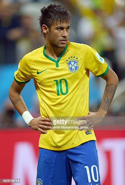 Neymar of Brazil look on during the 2014 FIFA World Cup Brazil Group A match between Brazil and Croatia at Arena de Sao Paulo on June 12 2014 in Sao...