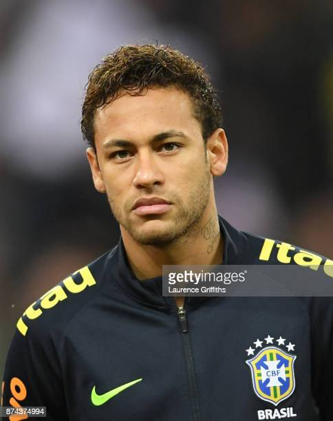 Neymar of Brazil looks on during the national anthems during the International Friendly match between England and Brazil at Wembley Stadium on...