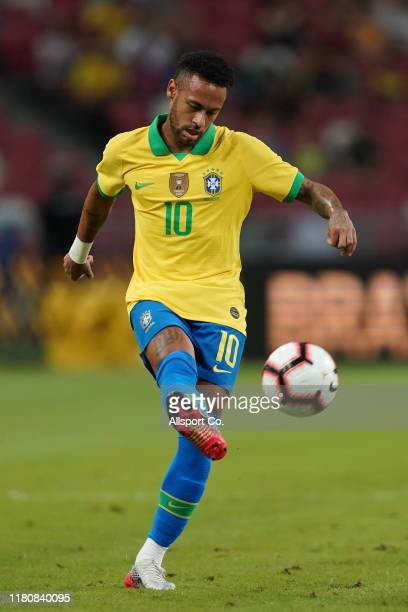 Neymar of Brazil passes the ball during the international friendly match between Brazil and Nigeria at the Singapore National Stadium on October 13,...