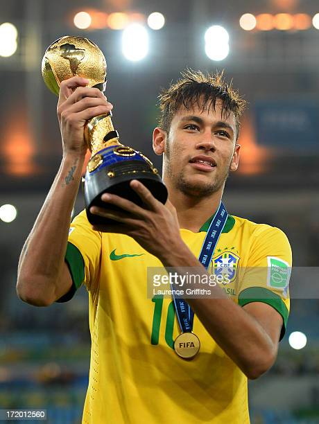 Neymar of Brazil poses with the trophy at the end of the FIFA Confederations Cup Brazil 2013 Final match between Brazil and Spain at Maracana on June...