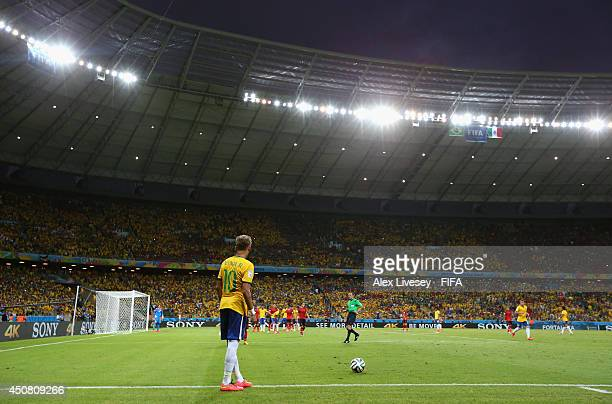 Neymar of Brazil prepares to take a free kick during the 2014 FIFA World Cup Brazil Group A match between Brazil and Mexico at Estadio Castelao on...