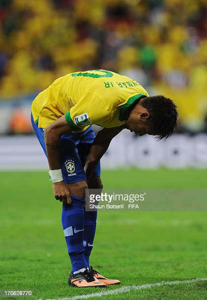 Neymar of Brazil pulls up his sock during the FIFA Confederations Cup Brazil 2013 Group A match between Brazil and Japan at National Stadium on June...