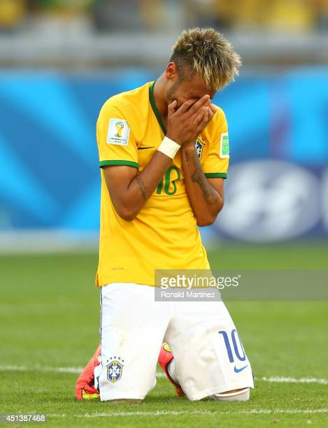 Neymar of Brazil reacts after defeating Chile in a penalty shootout during the 2014 FIFA World Cup Brazil round of 16 match between Brazil and Chile...