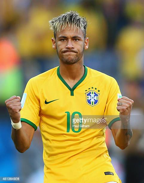 Neymar of Brazil reacts after scoring a penalty kick during the shootout of the 2014 FIFA World Cup Brazil round of 16 match between Brazil and Chile...