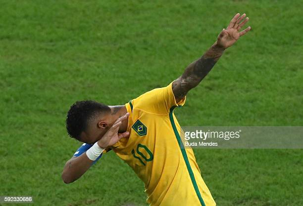 Neymar of Brazil reacts after scoring during the Men's Football Final between Brazil and Germany at the Maracana Stadium on Day 15 of the Rio 2016...