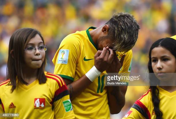 Neymar of Brazil reacts during the National Anthem prior to the 2014 FIFA World Cup Brazil Group A match between Brazil and Mexico at Castelao on...