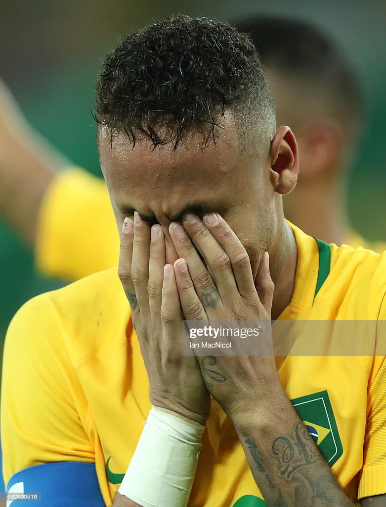 Neymar of Brazil reacts when Brazil win the penalty shoot out during Brazil versus Germany in the Men's football final match at Maracana Stadium on August 20, 2016 in Rio de Janeiro, Brazil.