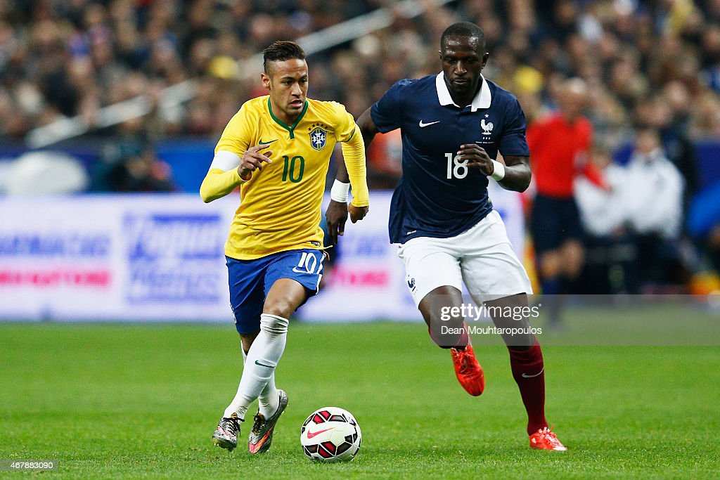 Neymar of Brazil runs on goal in front of Moussa Sissoko of France during the International Friendly match between France and Brazil at the Stade de France on March 26, 2015 in Paris, France.