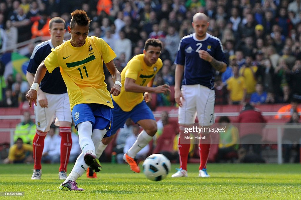 Neymar of Brazil scores from theiur second goal from the penalty spot during the International friendly match between Brazil and Scotland at Emirates Stadium on March 27, 2011 in London, England.