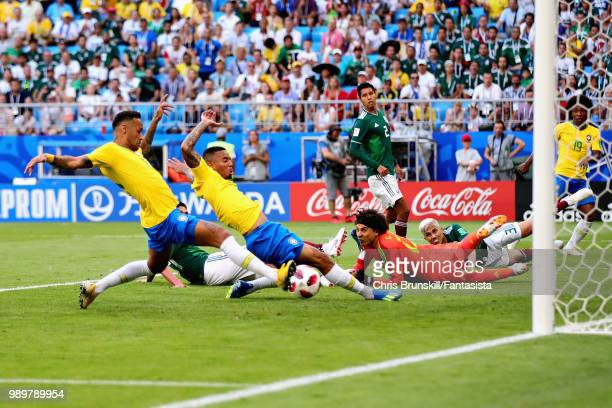 Neymar of Brazil scores his sides first goal during the 2018 FIFA World Cup Russia Round of 16 match between Brazil and Mexico at Samara Arena on...