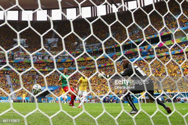 Neymar of Brazil scores his team's first goal past Charles Itandje of Cameroon during the 2014 FIFA World Cup Brazil Group A match between Cameroon...