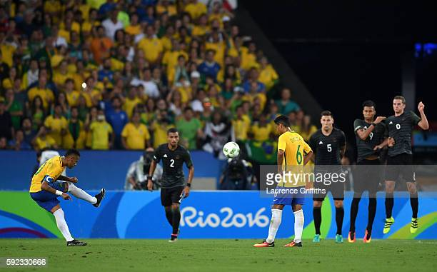 Neymar of Brazil scores the first Brazil goal during the Men's Football Final between Brazil and Germany at the Maracana Stadium on Day 15 of the Rio...