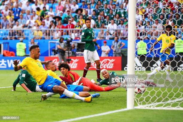 Neymar of Brazil scores the opening goal during the 2018 FIFA World Cup Russia Round of 16 match between 1st Group E and 2nd Group F at Samara Arena...