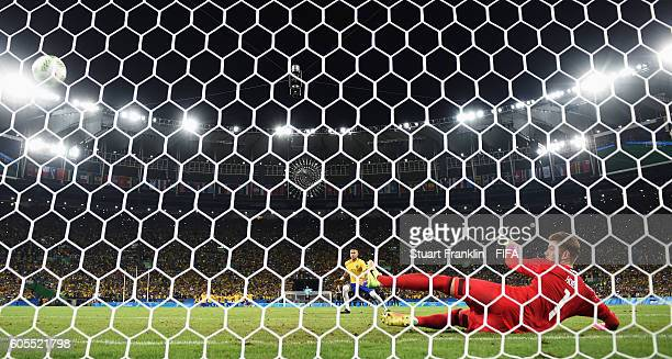 Neymar of Brazil scores the winning penalty at the Olympic Men's Final Football match between Brazil and Germany at Maracana Stadium on August 20...