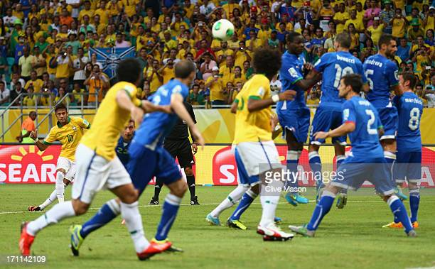Neymar of Brazil scores their second goal from a free kick during the FIFA Confederations Cup Brazil 2013 Group A match between Italy and Brazil at...