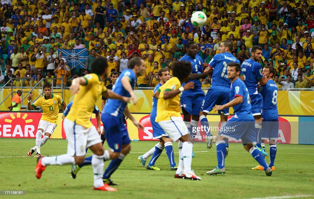 Neymar of Brazil scores their second goal from a free kick during the FIFA Confederations Cup Brazil 2013 Group A match between Italy and Brazil at Estadio Octavio Mangabeira (Arena Fonte Nova Salvador) on June 22, 2013 in Salvador, Brazil.