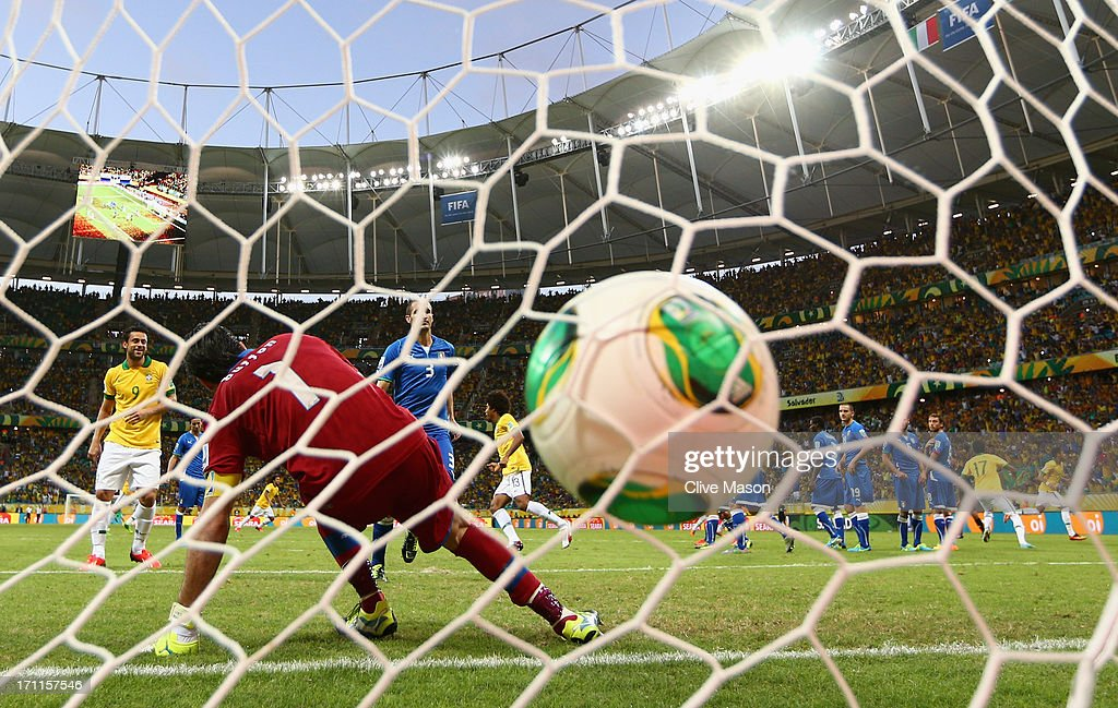 Neymar of Brazil (far right) scores their second goal from a free kick past goalkeeper Gianluigi Buffon of Italy during the FIFA Confederations Cup Brazil 2013 Group A match between Italy and Brazil at Estadio Octavio Mangabeira (Arena Fonte Nova Salvador) on June 22, 2013 in Salvador, Brazil.