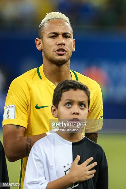 Neymar of Brazil sings the national anthem during a match between Brazil and Colombia as part of FIFA 2018 World Cup Qualifiers at Arena Amazonia...