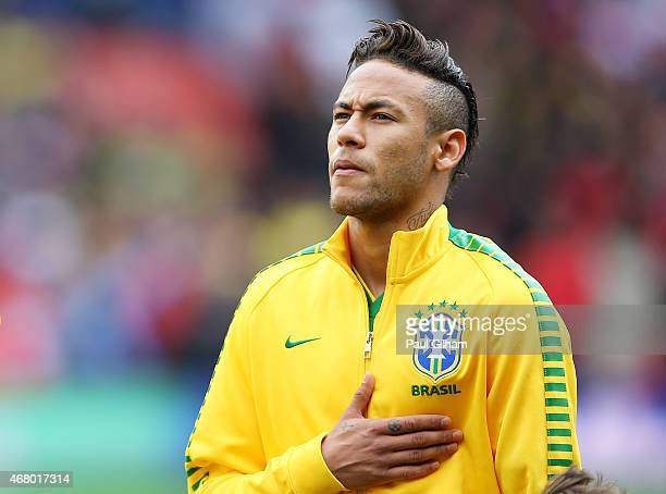 Neymar of Brazil sings the national anthem prior to kickoff during the international friendly match between Brazil and Chile at the Emirates Stadium...