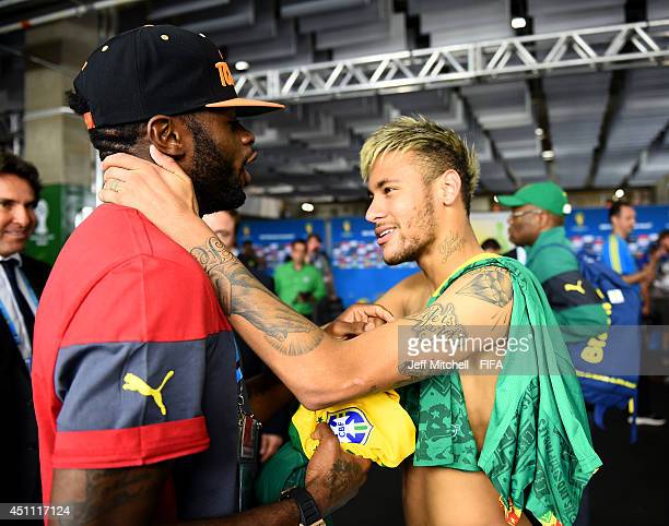 Neymar of Brazil speaks to Alexandre Song of Cameroon in the tunnel after the 2014 FIFA World Cup Brazil Group A match between Cameroon and Brazil at...