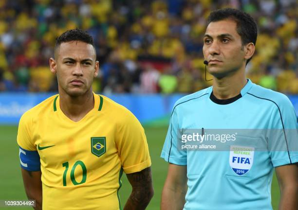 Neymar of Brazil stands next to referee Alireza Faghani of Iran prior to the Men's soccer Gold Medal Match between Brazil and Germany during the Rio...