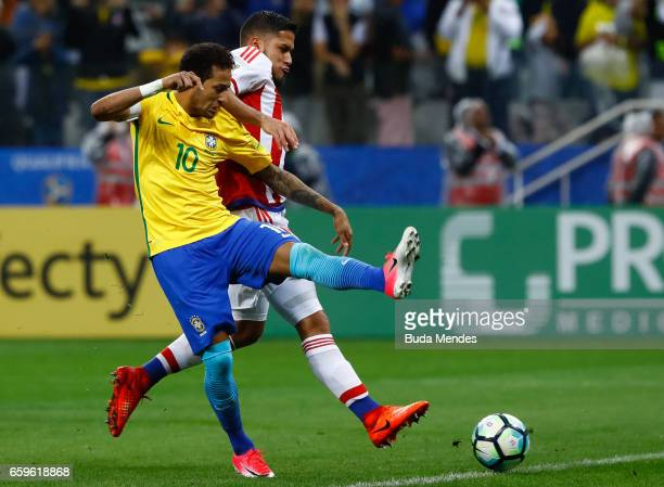 Neymar of Brazil struggles for the ball during a match between Brazil and Paraguay as part of 2018 FIFA World Cup Russia Qualifier at Arena...