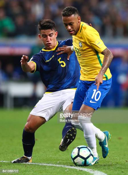 Neymar of Brazil struggles for the ball with Fernando Gaibor of Ecuador during a match between Brazil and Ecuador as part of 2018 FIFA World Cup...