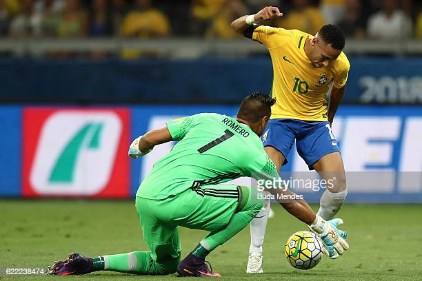 Neymar of Brazil struggles for the ball with goalkeeper Sergio Romero of Argentina during a match between Brazil and Argentina as part of 2018 FIFA...
