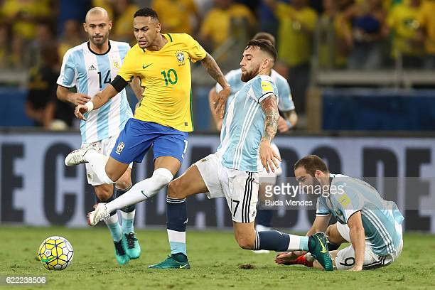 Neymar of Brazil struggles for the ball with Nicolas Otamendi of Argentina during a match between Brazil and Argentina as part of 2018 FIFA World Cup...