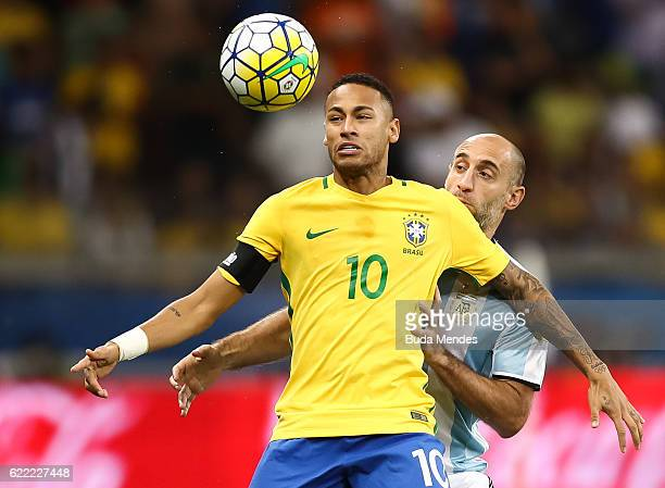 Neymar of Brazil struggles for the ball with Pablo Zabaleta of Argentina during a match between Brazil and Argentina as part of 2018 FIFA World Cup...