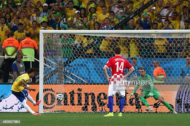 Neymar of Brazil takes a penalty kick against Stipe Pletikosa of Croatia as Marcelo Brozovic looks on during the 2014 FIFA World Cup Brazil Group A...