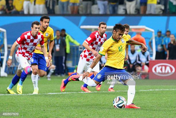 Neymar of Brazil takes a penalty kick in the second half during the 2014 FIFA World Cup Brazil Group A match between Brazil and Croatia at Arena de...