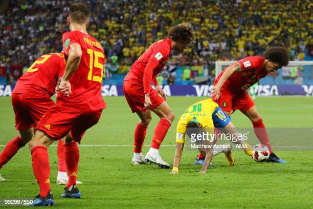 Neymar of Brazil tangles with Axel Witsel of Belgium during the 2018 FIFA World Cup Russia Quarter Final match between Brazil and Belgium at Kazan...