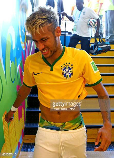 Neymar of Brazil walks in the tunnel after the win in the 2014 FIFA World Cup Brazil Round of 16 match between Brazil and Chile at Estadio Mineirao...