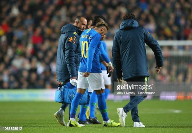Neymar of Brazil walks off injured during the International Friendly match between Brazil and Cameroon at Stadium mk on November 20 2018 in Milton...