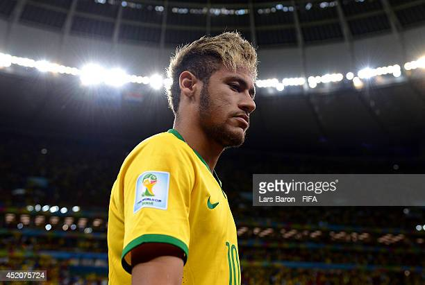 Neymar of Brazil walks off the pitch after the 2014 FIFA World Cup Brazil 3rd Place Playoff match between Brazil and Netherlands at Estadio Nacional...