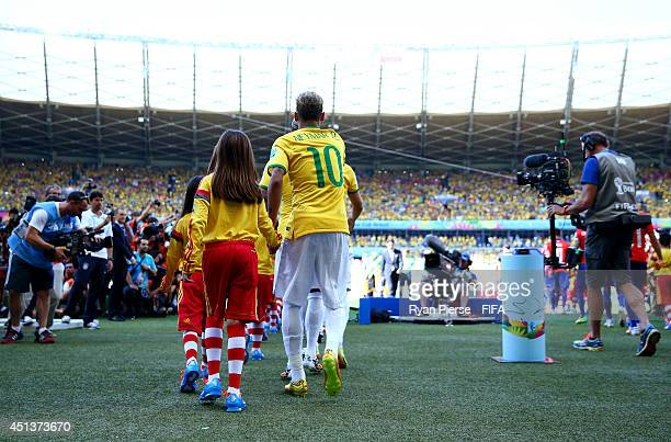 Neymar of Brazil walks on to the pitch prior to the 2014 FIFA World Cup Brazil Round of 16 match between Brazil and Chile at Estadio Mineirao on June...