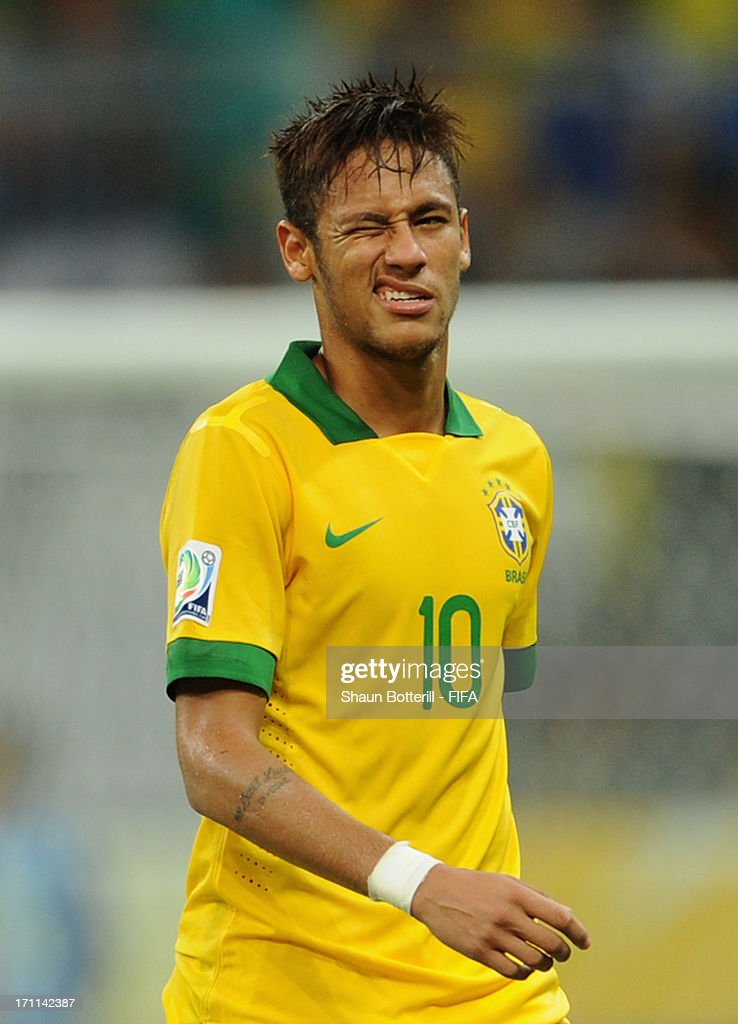 Neymar of Brazil winks as he is substituted during the FIFA Confederations Cup Brazil 2013 Group A match between Italy and Brazil at Estadio Octavio Mangabeira (Arena Fonte Nova Salvador) on June 22, 2013 in Salvador, Brazil.