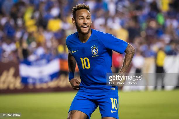 Neymar of Brazil with the captain's armband is all smiles to celebrate the goal by Richarlison of Brazil during the Brazil Global Tour and before the...