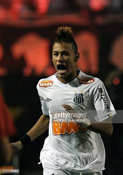 Neymar of Brazil's Santos celebrates after scoring against Uruguay's Penarol during their 2011 Copa Libertadores second leg final football match at...