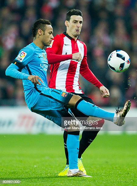 Neymar of FC Barcelola duels for the ball with Aritz Aduriz of Athletic Club during the Copa del Rey Quarter Final First Leg match between Athletic...